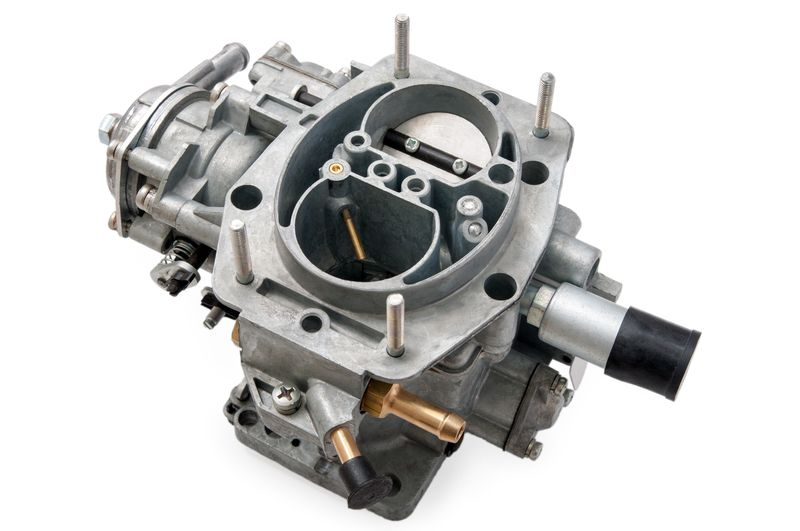 image showing a clean carburettor off a car
