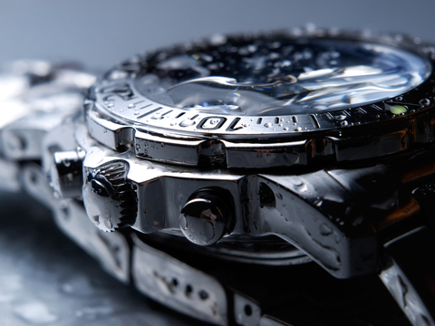 close up photo of a watch with water droplets after ultrasonic cleaning