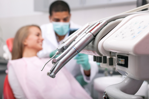 image of a dental surgery with a patient in a dentist chair