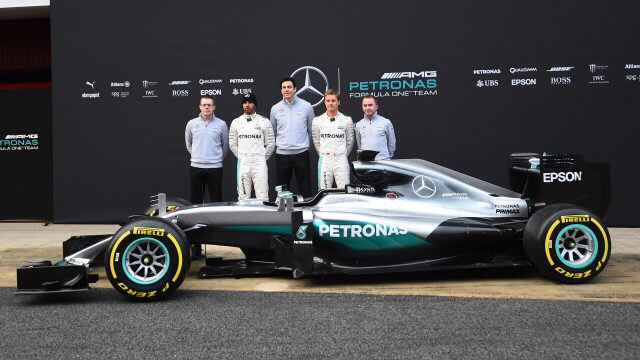 image of the 2016 formula one mercedes racing team with Lewis Hamilton standing with a racing car