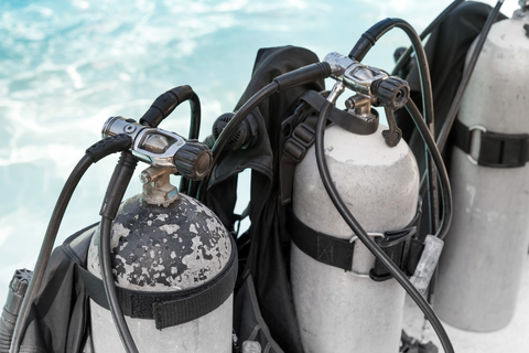 image of oxygen bottles and scuba diving equipment that can be cleaned in an ultrasonic cleaner