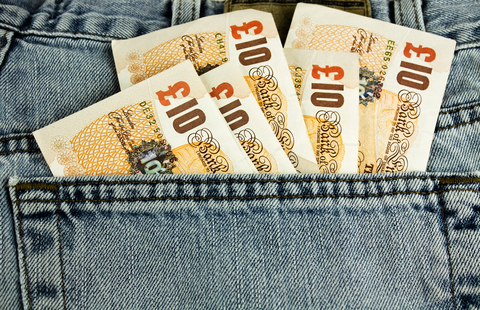 image of ten pound notes sticking out of the back pocket of a pair of jeans