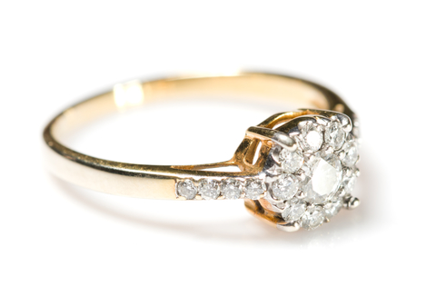 image of a cleaner gold wedding ring with a shiny diamond