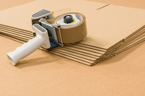 image of boxes and a packing tape dispenser