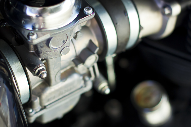 photo of a motorcycle carburettor suitable for ultrasonic cleaning fluid