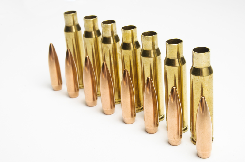 shiny brass rifle cases and brass bullets after  cleaning