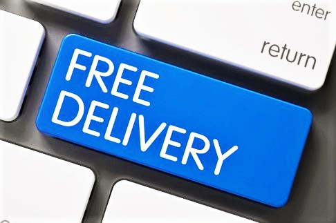 "photo of a keyboard with a key having the words ""free delivery"""