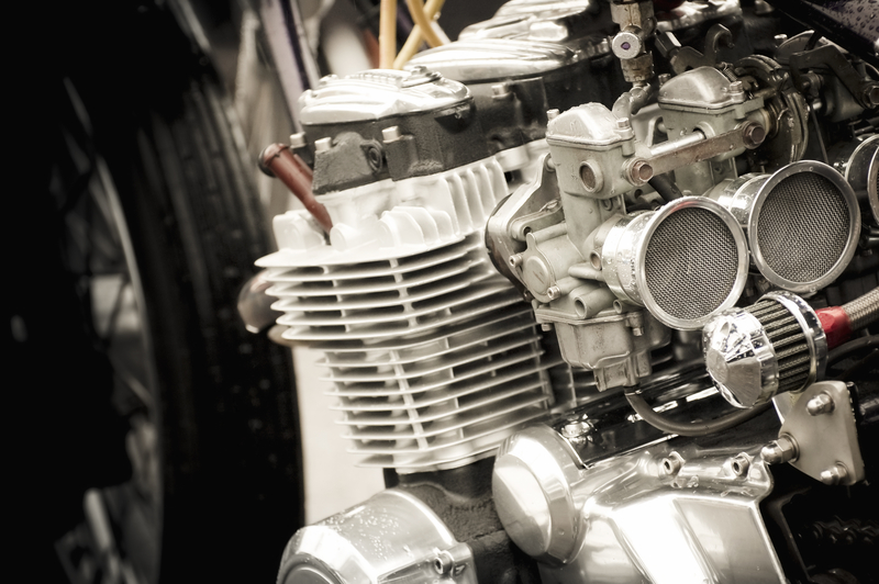 photo of a 4 cylinder motorbike engine with carburettors