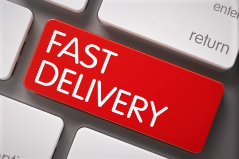"photo of a keyboard with a key having the words ""fast delivery"""