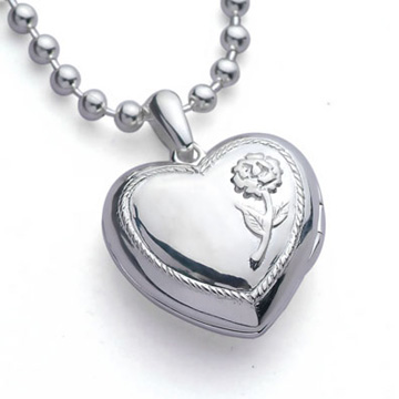 image of a silver heart shaped locket on a chain